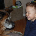 Smiling boy and dog