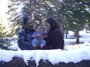Native American father and Dutch mother with son in the snow